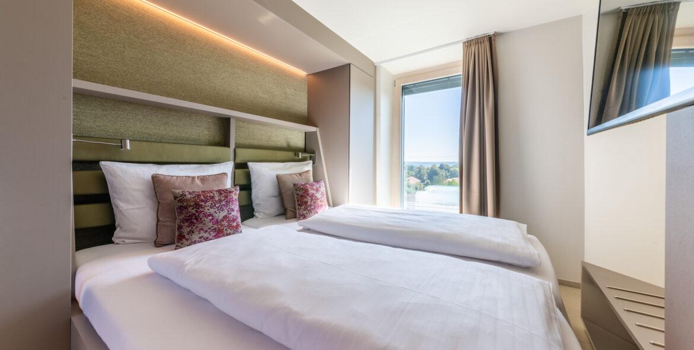 Etagenzimmer Bett